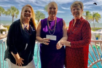 P.E.O. Sisterhood accepts scholarship donation.